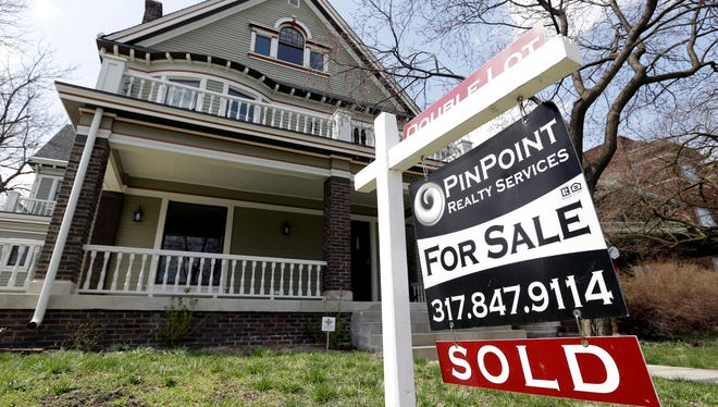 A sold sign is posted outside a home in Indianapolis on April 9, 2013.