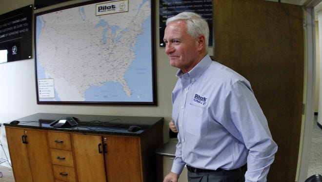 Jimmy Haslam, CEO of Pilot Flying J, enters a news conference at the company headquarters on April 19 in Knoxville, Tenn. A Pilot Flying J employee told investigators that Haslam, who is also the owner of the Cleveland Browns, knew about rebate fraud at the truck stop chain his family owns, according to an FBI affidavit unsealed Thursday.