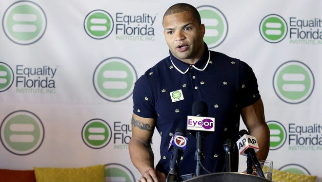Former Baltimore Ravens reserve linebacker Brendon Ayanbadejo talks to reporters about gay marriage in Fort Lauderdale, Fla., on Tuesday.