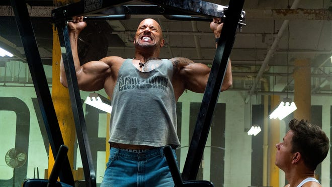 Dwayne Johnson, left, and Mark Wahlberg star in 'Pain & Gain.' The dark elements of the film's true story took their toll on Johnson.