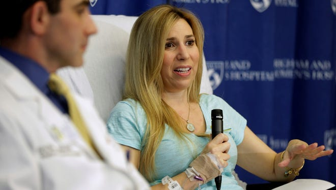Heather Abbott responds to questions from reporters Thursday at Brigham and Women's Hospital in Boston. Abbott underwent a below the knee amputation following injuries she suffered at the Boston Marathon bombings.