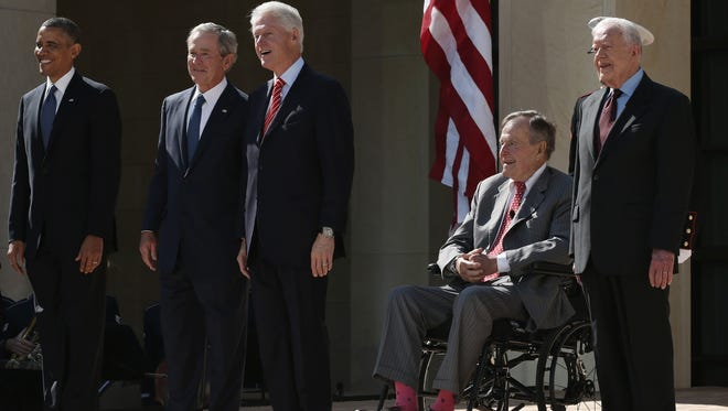 President Obama, left, former President George H.W. Bush, former President George W. Bush, former President Clinton and former President Carter attend the opening ceremony of the George W. Bush Presidential Center on Thursday in Dallas.