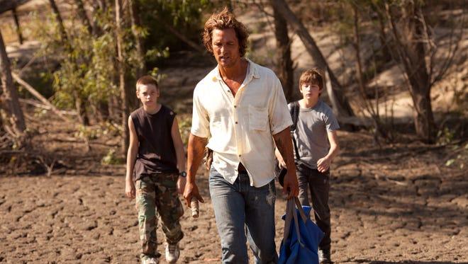 Jacob Lofland, left, Matthew McConaughey and Tye Sheridan star in 'Mud.'