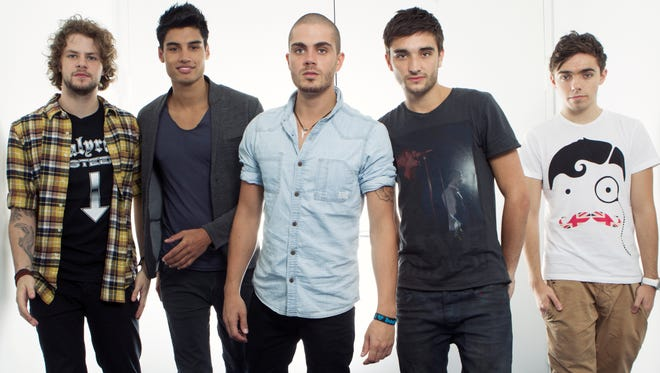 """British boy band """"The Wanted"""", from left, Jay McGuiness, Siva Kaneswaran, Max George, Tom Parker and Nathan Sykes posing for a portrait at JetBlue's T5 at JFK International Airport in New York."""
