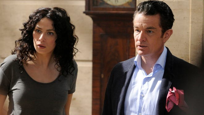 Joanne Kelly stars as Myka Bering with guest  James Marsters as Prof. Sutton in Syfy's 'Warehouse 13'
