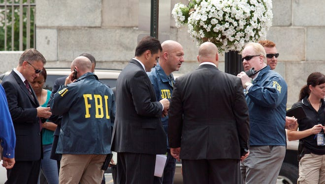 Washington police and FBI agents gather outside the Family Research Council in Washington in August 2012, after security guard at the lobbying group was shot in the arm.