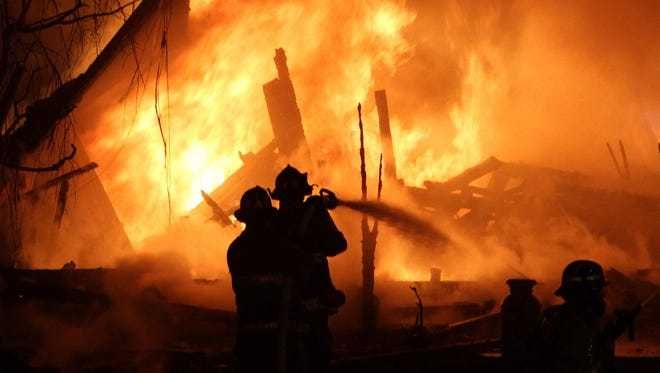 Carmel, N.Y. firefighters work a fire that destroyed the Sullivan family home on May 1, 2012. The fire killed four of the five family members. Authorities ruled the fire accidental.