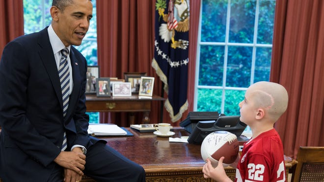 President Barack Obama greets 7-year-old Jack Hoffman in the Oval Office on April 29, 2013.