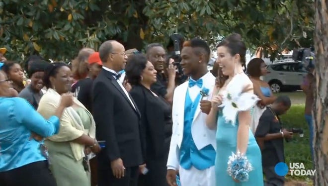 Students at Georgia's Wilcox County High School turned out in big numbers Saturday for the school's first integrated prom in Cordele, Ga.
