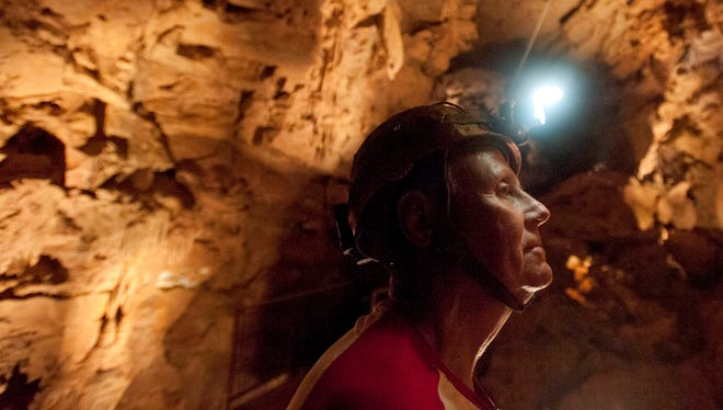 Gary Roberson, a member of the National Speleological Society, inspects a cave on April 12, 2013, south of  Corydon, Ind. Roberson is one of four partners developing the cave into an attraction.