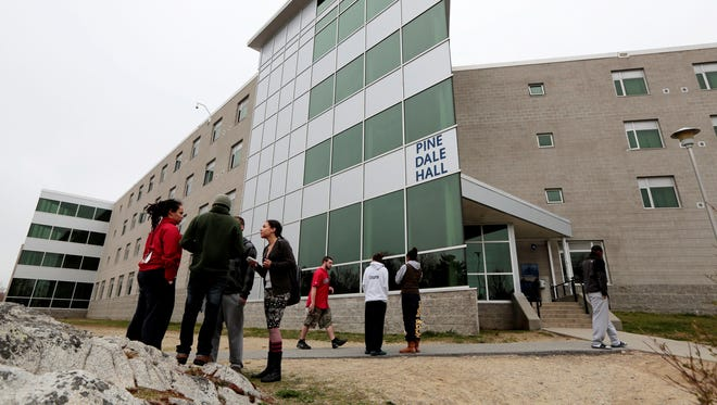 UMass-Dartmouth students stand outside Pine Dale Hall dormitory on April 19, 2013 in Dartmouth, Mass. as students are evacuated from the building so authorities can investigate the room occupied by Dzhokhar Tsamaev. Boston Police on Wednesday said that had taken three suspects into custody in connection with the case. NBC News said the three are students at the university who allegedly help Dzhokhar remove items from his dorm room in the days after the bombing.