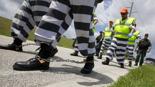 A new program at the Brevard County, Fla., jail allows volunteer inmates to work on a chain gang cleaning roadsides.