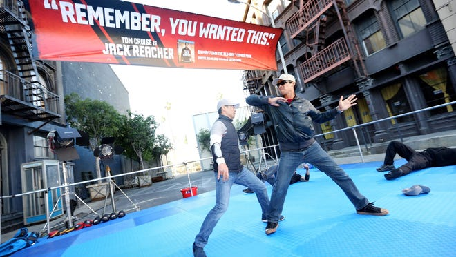 Fight coordinator Robert Alonzo, right, demonstrates moves from a no-holds-barred street fight  on stuntman Sam Le at featured in the film 'Jack Reacher,' available now for Digital Download and on Blu-ray and DVD May 7th.