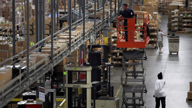 Employees sort holiday orders last Nov. 29 at the GSI Commerce warehouse in Louisville, Ky.  GSI Commerce is an eBay subsidiary has handled online retail sales for other companies as well.