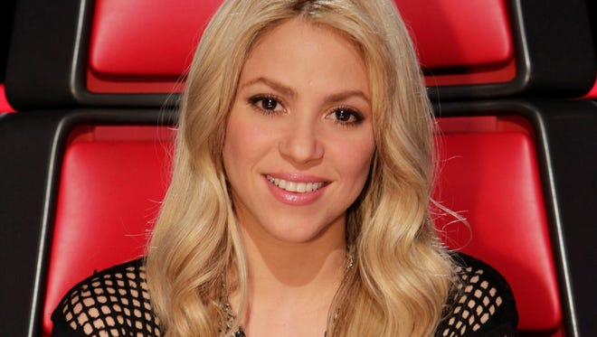 Coach Shakira watches the live performances on 'The Voice.'