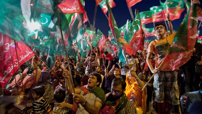 Supporters of Pakistan Tehreek-e-Insaf or Moment for Justice party attend an election campaign rally in Islamabad, Pakistan, Thursday, May 9, 2013. Pakistan is scheduled to hold parliamentary elections on May 11, the first transition between democratically elected governments in a country that has experienced three military coups and constant political instability since its creation in 1947. The parliament's ability to complete its five-year term has been hailed as a significant achievement. (AP Photo/Anjum Naveed) ORG XMIT: ANJ113