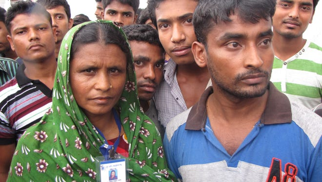 Machinery operator Ripom Muhammed Abu, right, worked at  the factory along with Mossanaam Amina, left, a cleaner.