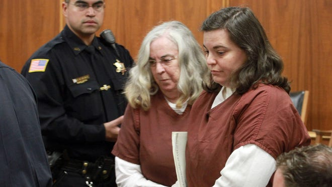 Kathleen Dorsett, right, the former elementary school teacher who, with her father, is accused of killing her ex-husband, appears with her mother Lesley Dorsett for a hearing in Freehold, N.J. on March 19, 2013. She admitted in court on May 9, that she sent her ex-husband to the back of her home, where her father was waiting to kill him.