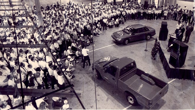 Subaru-Isuzu Automotive employees gather in the Lafayette, Ind. plant to celebrate the first Subaru car and Isuzu pickup to roll off the line in September 1989.