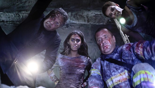 Patricio Strahovsky, left, Lorenza Izzo, Marcial Tangle, and Andrea Osvart fight to survive after a series of earthquakes in 'Aftershock.'