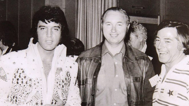 Longtime television director Marty Pasetta, right, is photographed with Elvis Presley. Pasetta directed numerous live television programs including Presley's 1973 Aloha from Hawaii concert.
