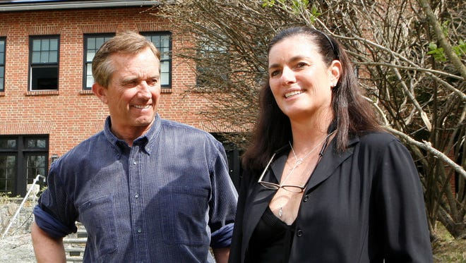 Robert Kennedy Jr, stands with wife, Mary Richardson Kennedy in the rear of his home in Bedford, N.Y. on April 6, 2010.