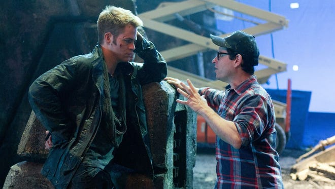 Chris Pine, left, who plays Captain Kirk, with director J.J. Abrams on the set of 'Star Trek Into Darkness.'