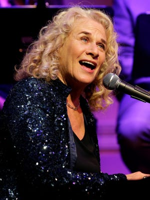 Singer/songwriter Carole King performs during an event to honor her with the Gershwin Prize for Popular Song at the Library of Congress, May 21, 2013, in Washington.