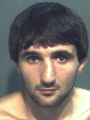 Ibragim Todashev is shown in a  police booking photo following his arrest May 4 on aggravated battery charges.