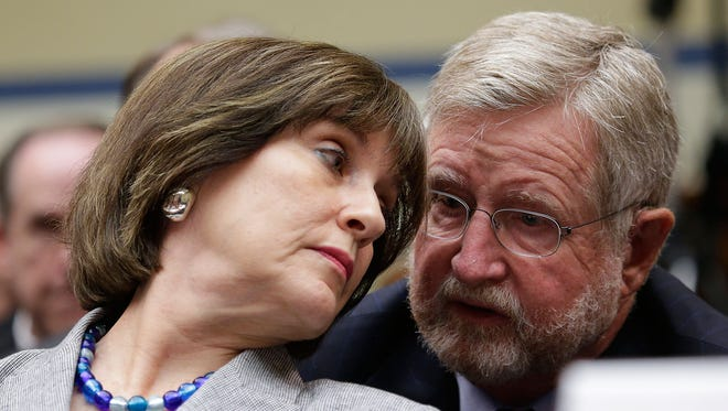 Lois Lerner, director of Exempt Organizations at Internal Revenue Service, consults with her lawyer before invoking her 5th amendment right not to testify before the House Oversight Committee.