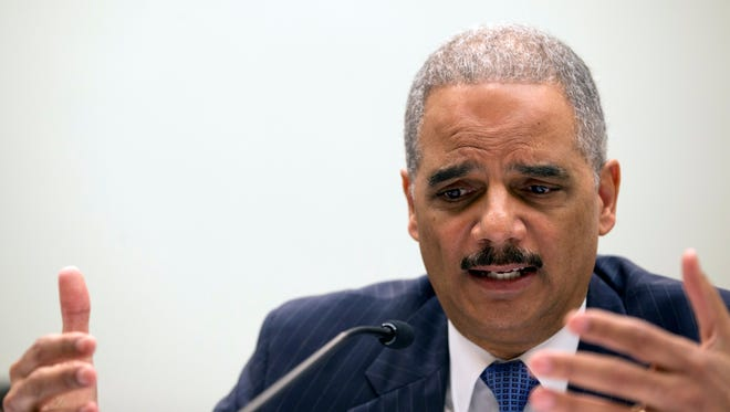 Attorney General Eric Holder testifies on Capitol Hill in Washington, Wednesday, May 15, 2013, before the House Judiciary Committee oversight hearing on the Justice Department. (AP Photo/Carolyn Kaster) ORG XMIT: DCCK129