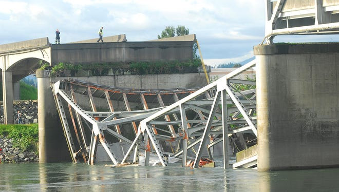 A portion of the Interstate 5 bridge is submerged after it collapsed into the Skagit River dumping vehicles and people into the water in Mount Vernon, Wash., Thursday.