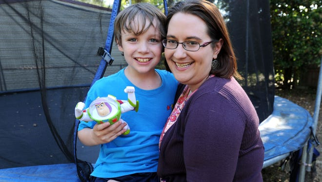 Max Blanton, 9, is photographed with his mother Jennifer Findley. Max, who is autistic, wears a Project Lifesaver tracking device on his ankle that allows authorities and his parents to find him if he wanders off.