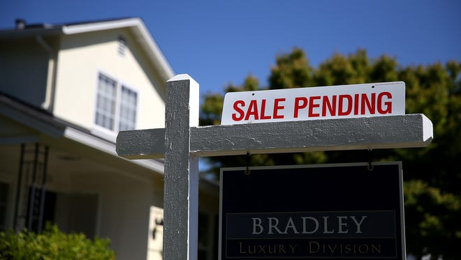 A sale pending sign is posted in front of a home for sale on May 22 in San Anselmo, Calif.