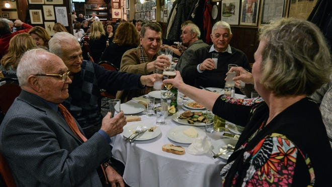 People toast with beer and raki, a traditional Turkish aniseed-based alcoholic drink, at a  restaurant in Istanbul on March 16.