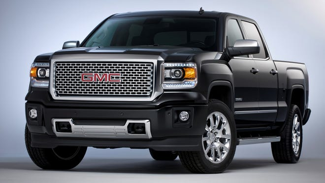 GMC 2014 Sierra Denali pickup will offer a 6.2-liter V-8  rated a hefty 420 hp, able to tow 12,000 lbs. Crew-cab Denali pictured with 20-inch chrome wheels.