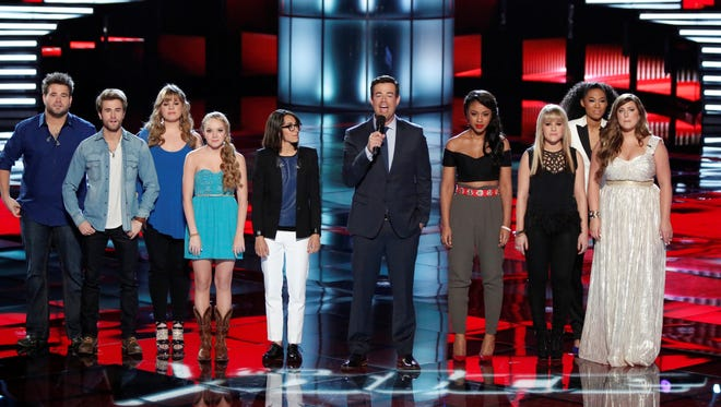 The final eight wait to hear who's sent home on 'The Voice.' Pictured: Zach Swon, left, Colton Swon of The Swon Brothers, Holly Tucker, Danielle Bradbery, Michelle Chamuel, Carson Daly, Sasha Allen, Amber Carrington, Judith Hill and Sarah Simmons
