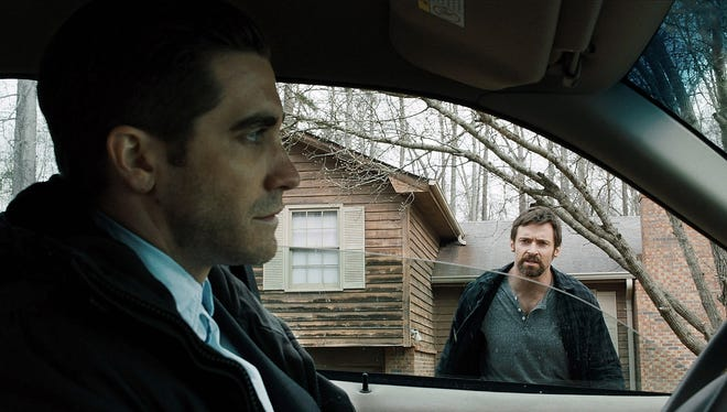 Jake Gyllenhaal, left, as Detective Loki and Hugh Jackman as Keller Dover in 'Prisoners.' In the film, the pair are at odds at the best way to investigate the kidnapping of Dover's daughter.