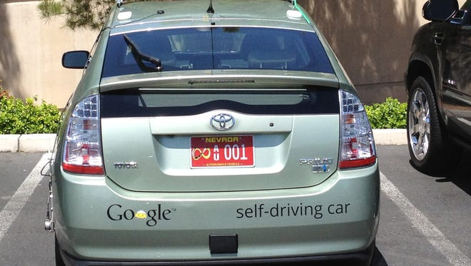 May 7, 2012 photo of the first officially licensed Google self-driving car, a Toyota Prius hybrid, that got its Nevada plates after its application was approved to test the car on public roads under a new law that put Nevada at the forefront of autonomous vehicle development.