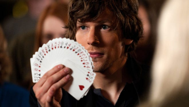 Jesse Eisenberg stars in the clumsily-executed 'Now You See Me,' which features a group of magicians trying their hands at bank robbery.