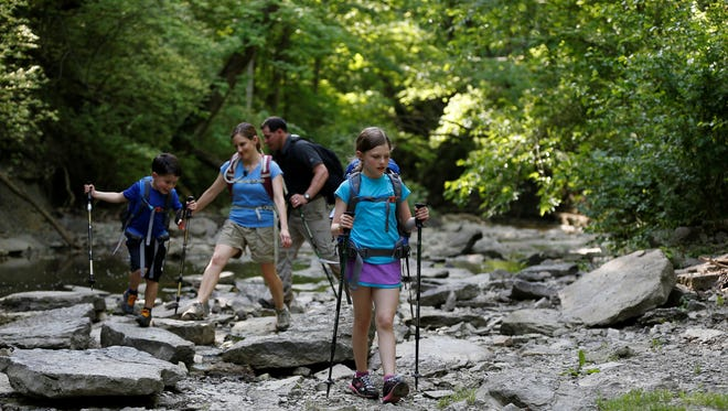 Jeff and Beth Alt of Cincinnati took their family to Sharon Woods to show off equipment (trekking poles and backpacks with water bladders) they would use on any major hikes with their kids.