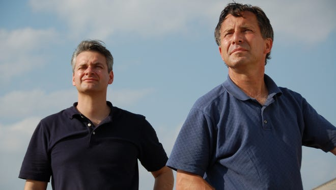 Carl Young, left, and Tim Samaras watch the sky. The two were killed along with Tim Samaras' son May 31 in an Oklahoma tornado.