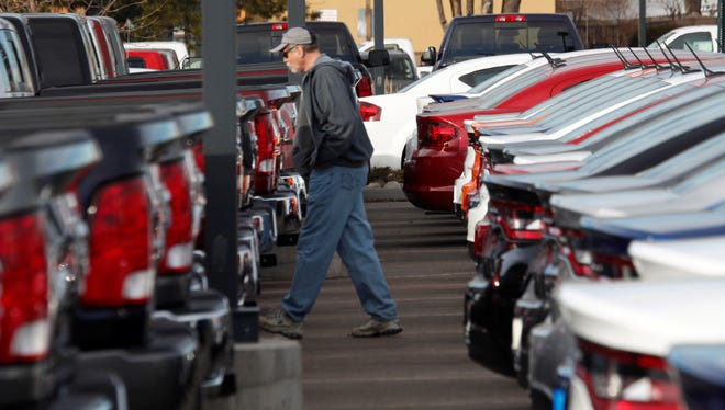 File photo of a car shopper at a dealership in Littleton, Colo.