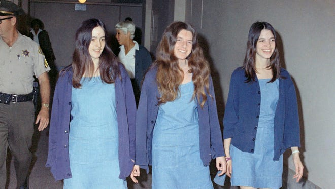 Charles Manson followers (left to right) Susan Atkins, Patricia Krenwinkel and Leslie Van Houten are shown walking to court on Aug. 20, 1970, in Los Angeles to appear on charges involving the 1969 cult killings of seven people, including pregnant actress Sharon Tate.
