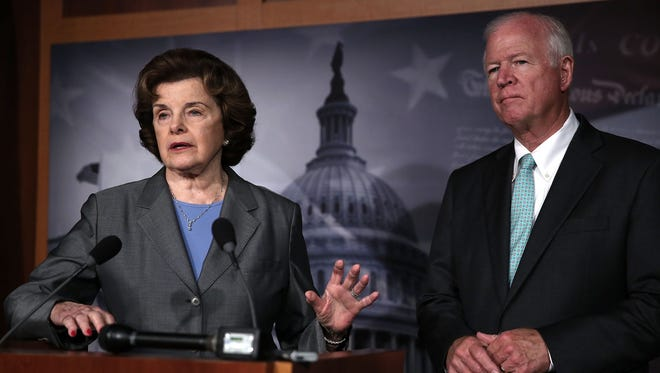 Sen. Dianne Feinstein, D-Calif., and Sen. Saxby Chambliss, R-Ga., speak to members of the media about the National Security Agency collecting phone records  Thursday.