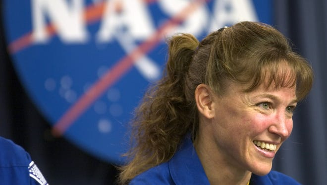 Mission Specialist Lisa Nowak speaks at a post mission press conference July 17, 2006 at Kennedy Space Center in Florida. Discussed was the progress the mission had made on the completion of the International Space Station.