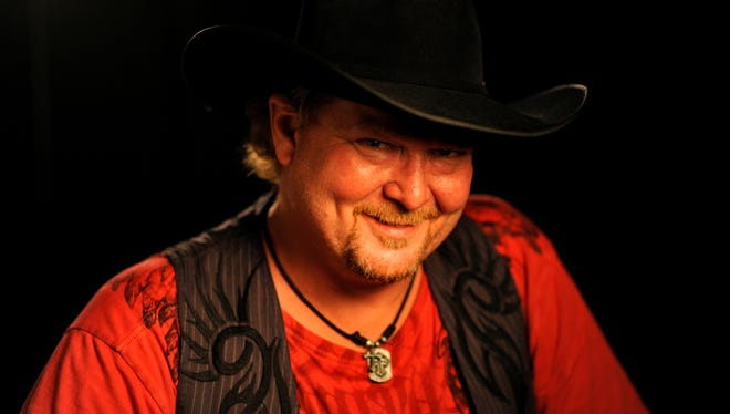 Tracy Lawrence poses for a portrait prior to performing at the 2013 CMA Music Festival.