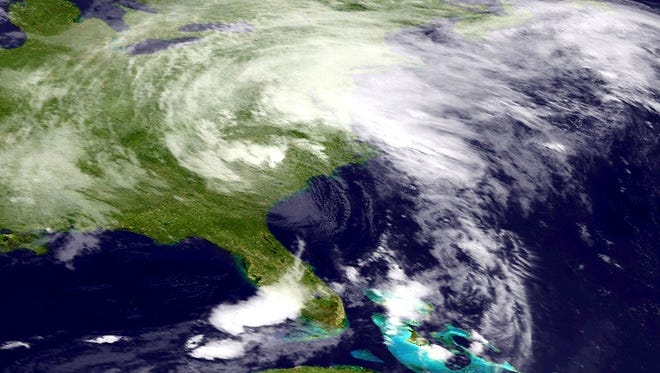 A satellite image shows Tropical Storm Andrea on Friday morning. The storm has maximum sustained winds of 45 mph and was moving to the northeast at 28 mph.