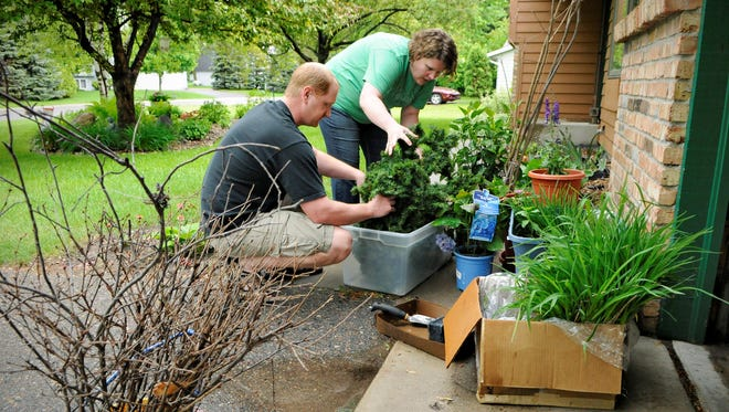 Jakin and Nicole Koll, Sartell, preparing items for a parade float on June 5, have both been diagnosed with Lyme Disease and are working to make others aware of the disease with their outdoor themed float.