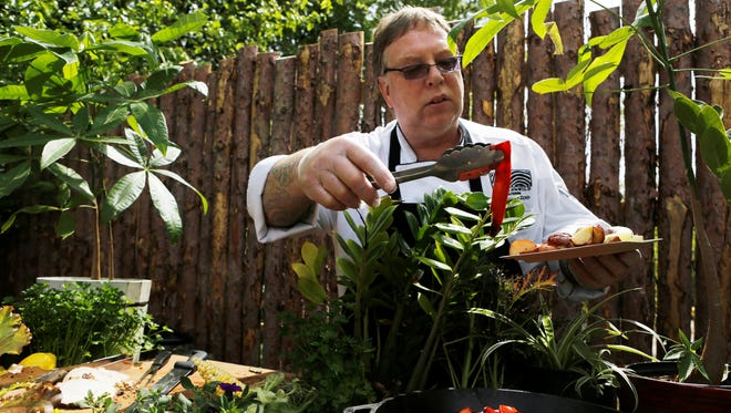 Chef Steven Banks serves fresh produce from the outdoor buffet at Base Camp Cafe, the new restaurant at the Cincinnati Zoo , Botanical Garden. Base Camp Cafe has been designated the greenest restaurant in the country by the Green Restaurant Association.